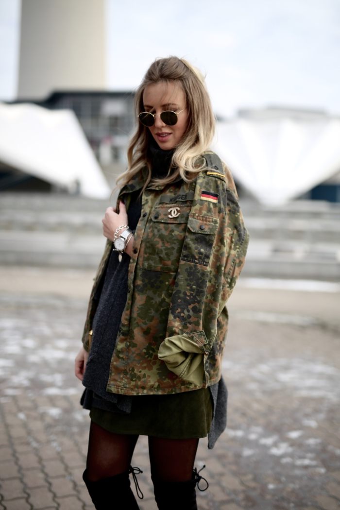 camouflage jacket, black oversized sweater, sunglasses