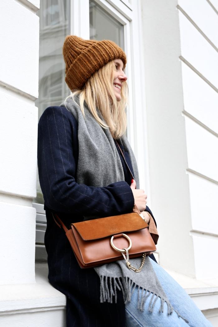 Cloé purse, blue coat, grey scarf, beanie