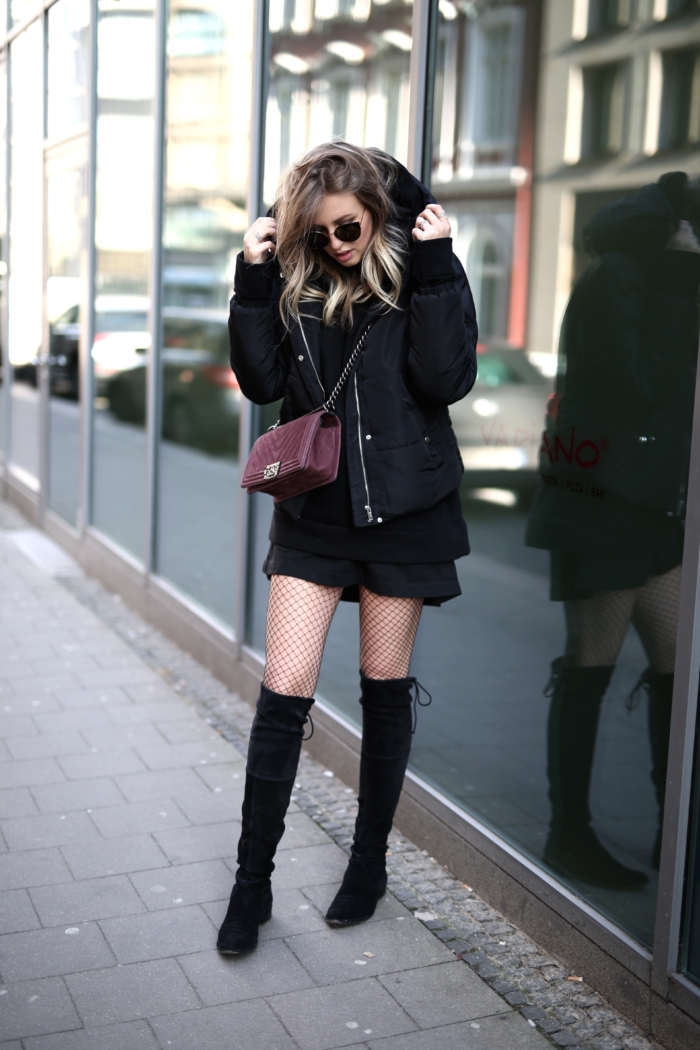 black oversized hoodie, Chanel purse, fishnet tights, overknee boots