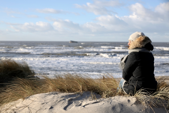 denmark, coast, waves, winter parka, scarf