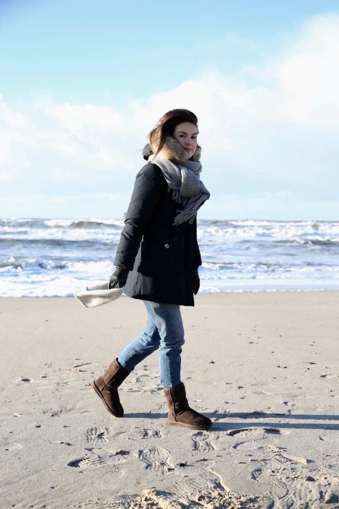 walk at the beach, winter parka, jeans, boots