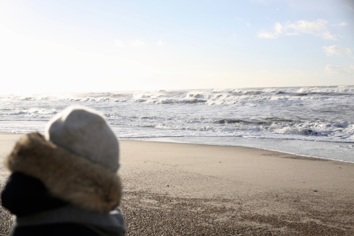 beach in winter, warm jacket, hat