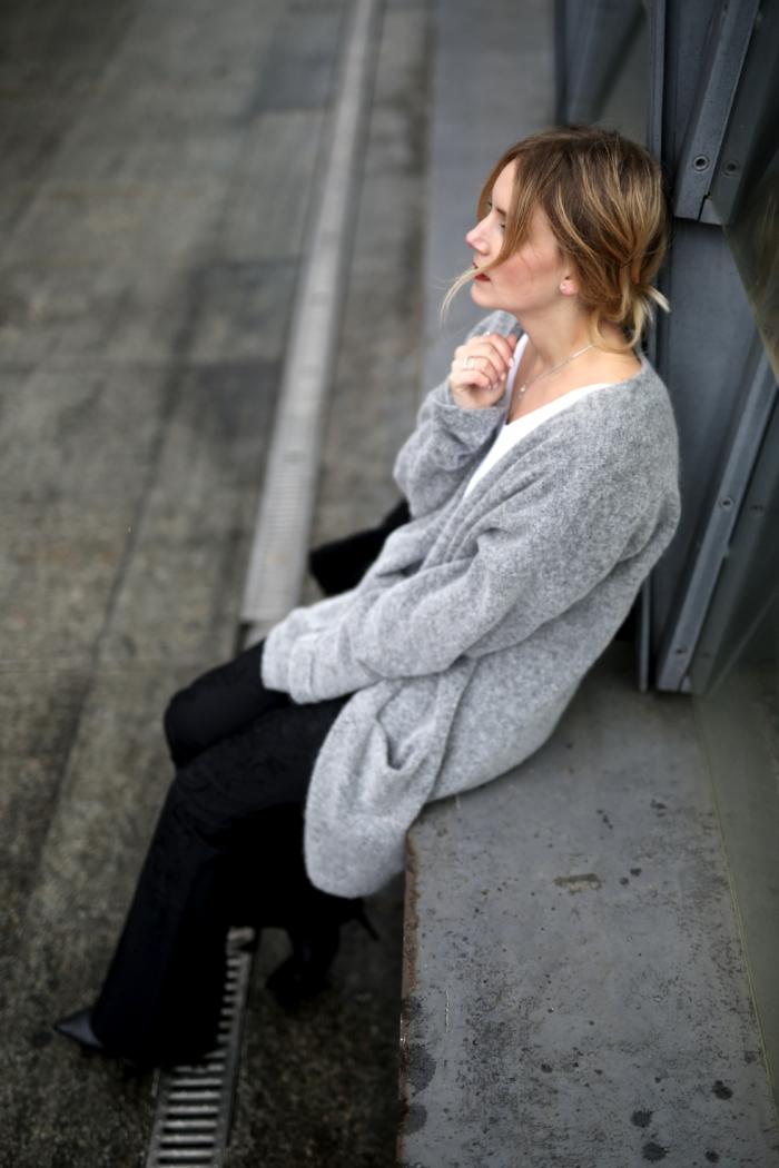 grey oversized cardigan, white shirt, black pants