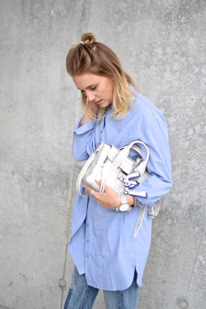 baby blue blouse, silver bag, silver watch