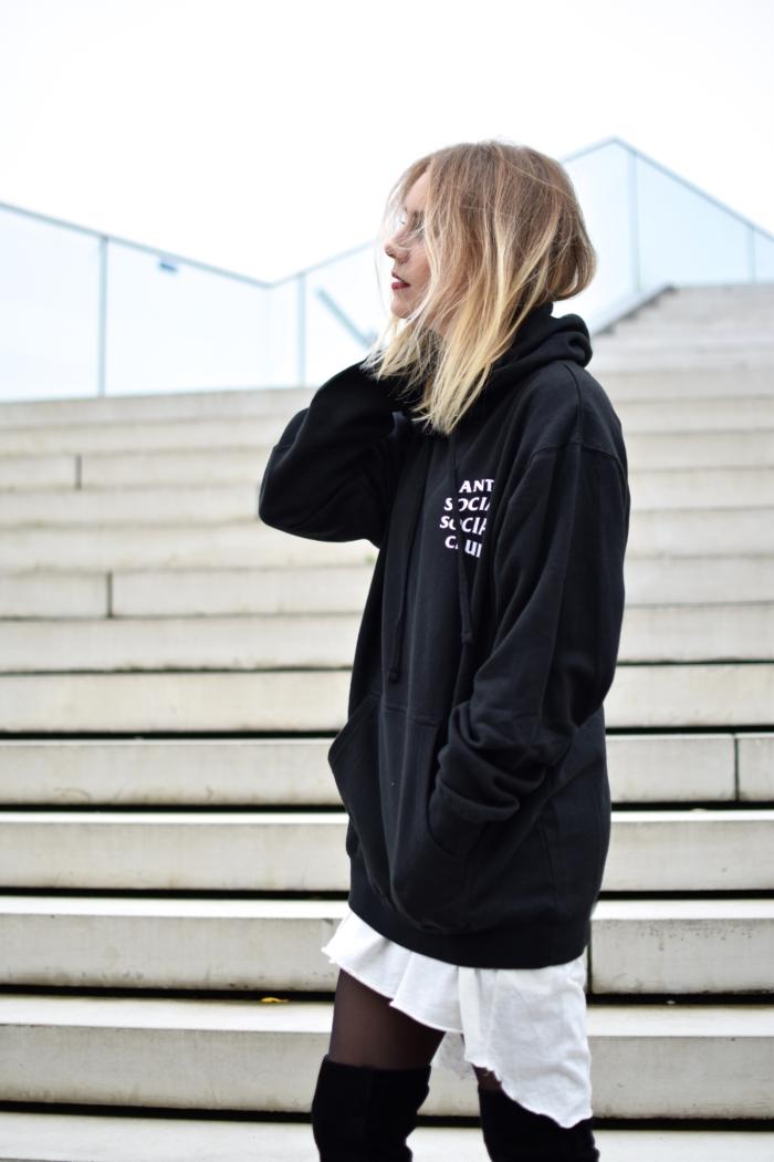 black xxl sweater, short blonde hair