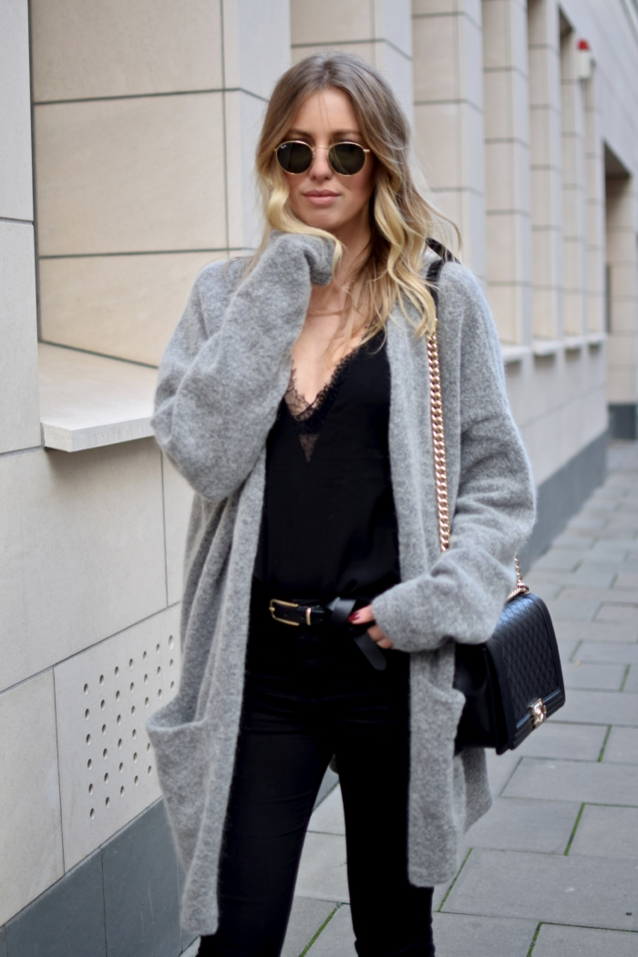 grey xxl cardigan, black top, Ray Ban sunglasses