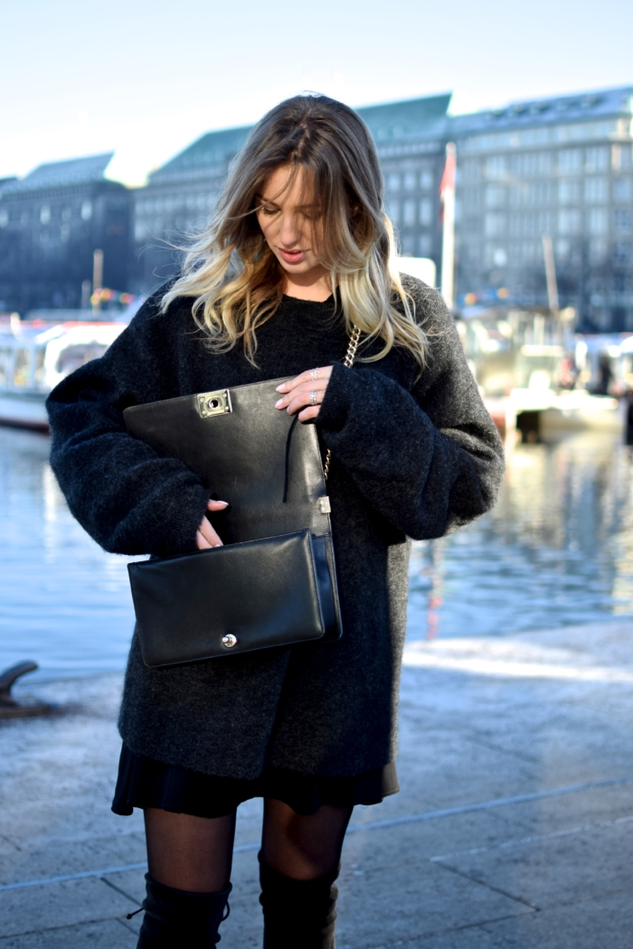 Hamburg port, black sweater, open handbag